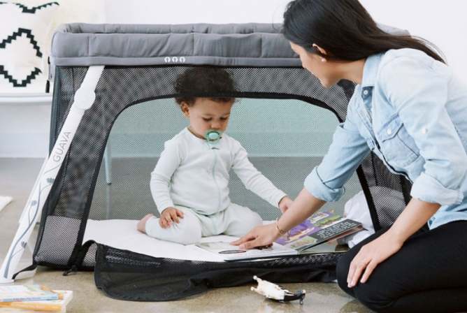 Lotus Travel Crib has a zipper side door makes for easy play