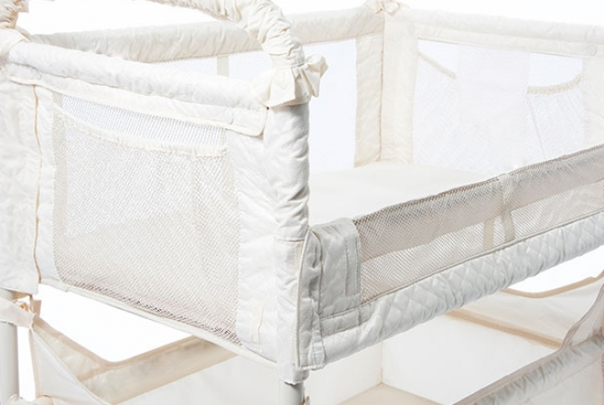 The side wall folds down for easy co-sleeping